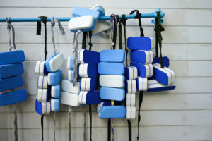 swim belts hanging on a wall