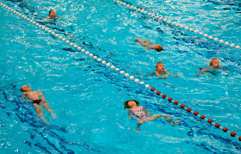 children at swimming lesson